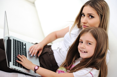 Mother and daugther with laptop on sofa Stock Photo - 11176833