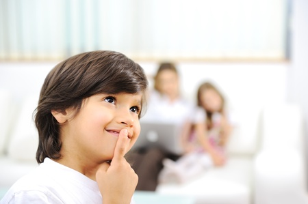Little cute boy thinking, at home with family Stock Photo - 11176622