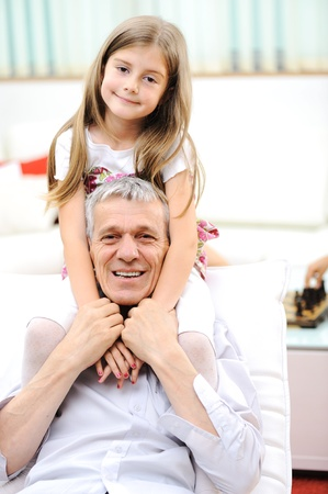 Grandfather and his little girl indoor photo