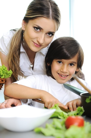 Beautiful mother and little son in kitchen together Stock Photo - 11176819