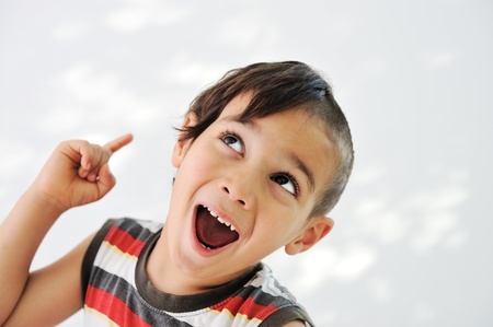 hardrock: Cute little boy with funny hair and cheerful grimace Stock Photo