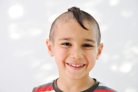 Cute little boy with funny hair and grimace Stock Photo - 11176611