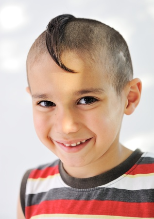 Cute little boy with funny hair and cheerful grimace Stock Photo - 11176823