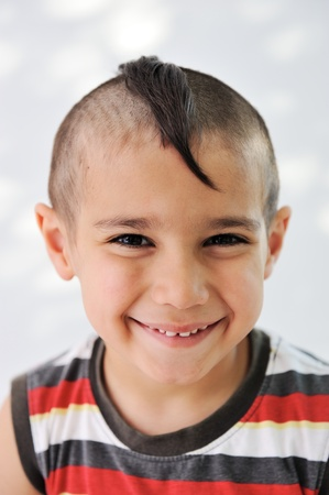 Cute little boy with funny hair and grimace Stock Photo - 11176835