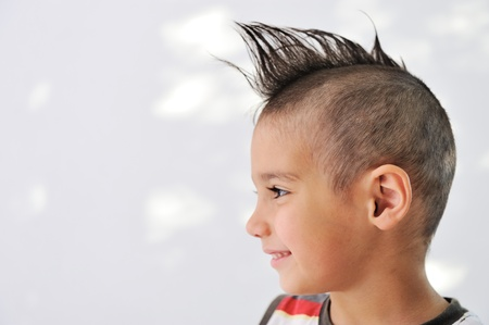 Cute little boy with funny hair and cheerful grimace Stock Photo - 11176732
