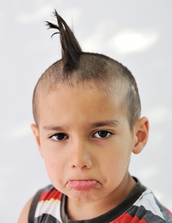 Cute little boy with funny hair and cheerful grimace Stock Photo - 11176710