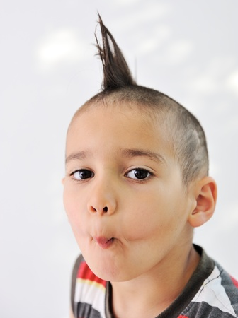 Cute little boy with funny hair and cheerful grimace Stock Photo - 11176546