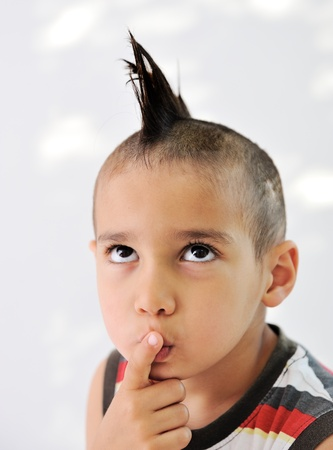 Cute little boy with funny hair and cheerful grimace Stock Photo - 11176694