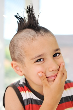 Cute little boy with funny hair and grimace Stock Photo - 11176810