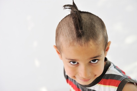 Cute little boy with funny hair and grimace Stock Photo - 11176687