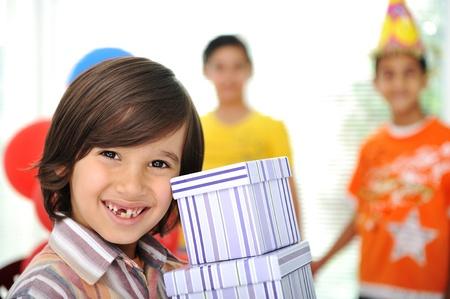 three gift boxes: Birthday party, happy children celebrating, balloons and presents around Stock Photo