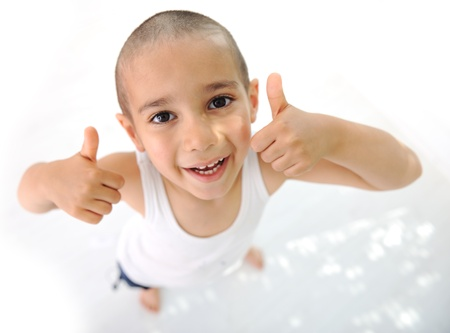 Thumbs up! Little boy, cute short hair, almost bald :) photo
