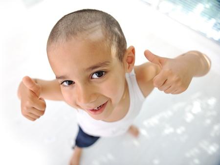 Thumbs up! Little boy, cute short hair, almost bald :) photo