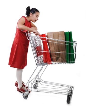 reduced value: Comprador ni�a de vestido rojo con carrito de compras