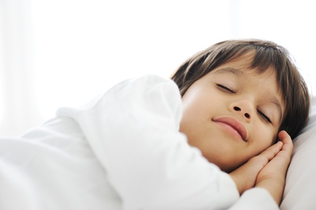 sleeping kid: Kid on sleeping bed, happy bedtime in white bedroom