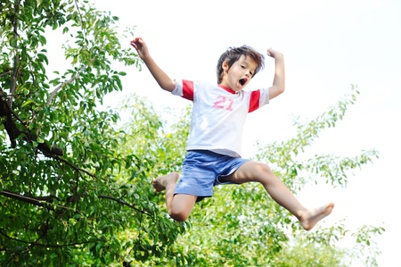 trampoline: Jumping kid in the air