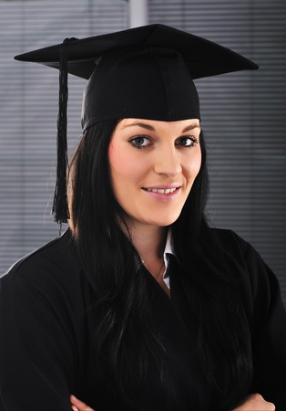 Student girl in an academic gown, graduating and diploma Stock Photo - 11176890