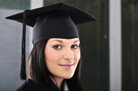 Student girl in an academic gown, graduating and diploma Stock Photo - 11176894