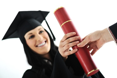 Graduate girl student in gown receiving diploma photo