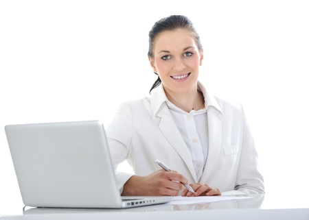 Business woman on desk working on laptop Stock Photo - 11176593