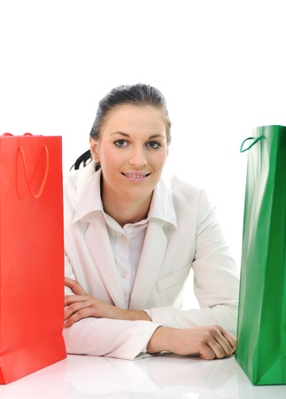 Beautiful young female with shopping bags photo