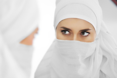 middle eastern: Young beautiful mysterious Muslim woman Stock Photo