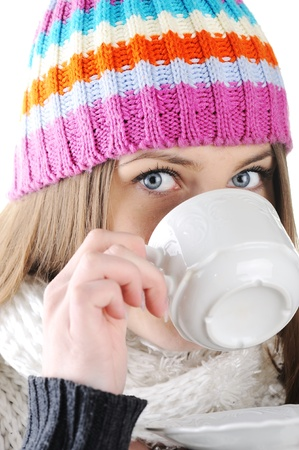 Happy Winter Beautiful Girl drinking hot tea photo
