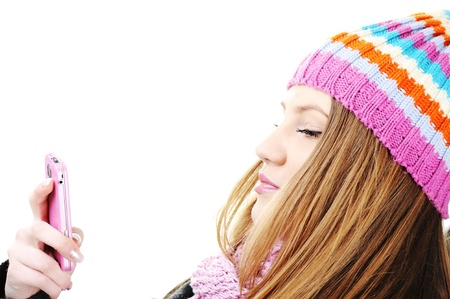 Winter Beautiful Girl reading sms message on cell phone photo