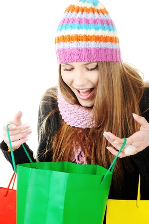 Beautiful winter girl with shopping bags photo