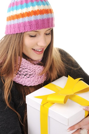 Winter girl with gift box photo