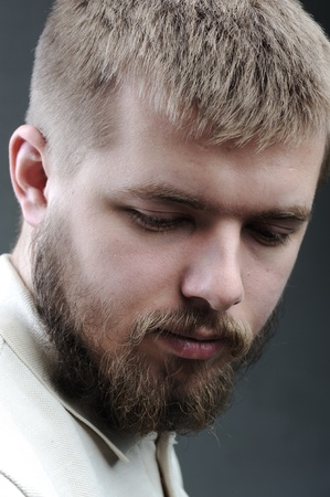 Portrait of young man with beard photo