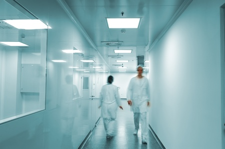 health facilities: Modern bright factory interior with working people in motion