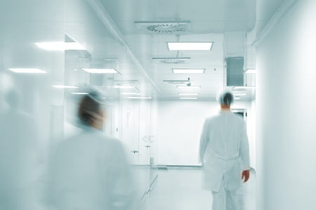 hospital corridor: Working people with white uniforms walking in modern  factory environment