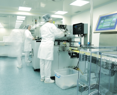 plant drug: Automated production line in modern drug factory Stock Photo