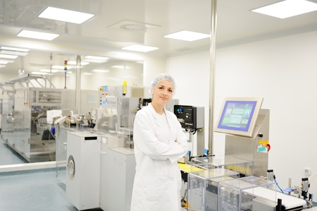 production line factory: Woman at automated production line in modern factory Stock Photo