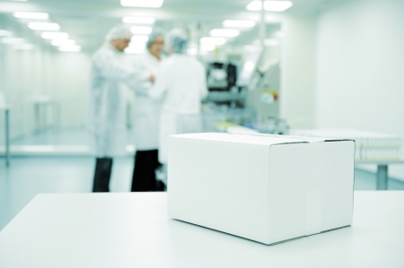 White box at automated production line at modern factory - ready for your logo photo