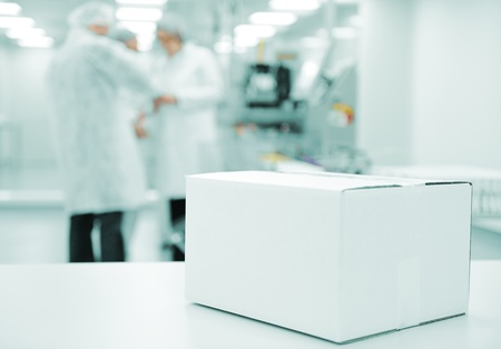food distribution: White box at automated production line at modern factory - ready for your logotype