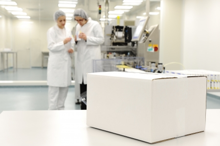 food distribution: White box at automated production line at modern factory - ready for your logo
