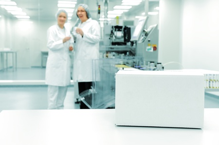 White box at automated production line at modern factory photo