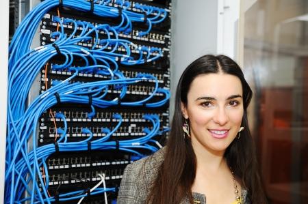 datacenter: Female administrator at server room