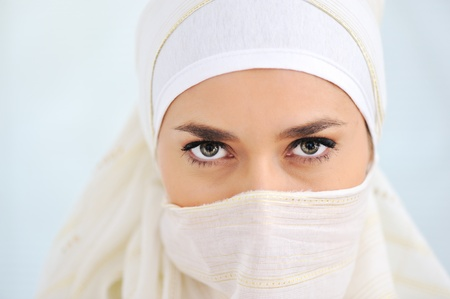 Muslim woman with veil looking at camera photo