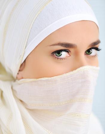 arabic woman: Muslim woman with veil looking at camera