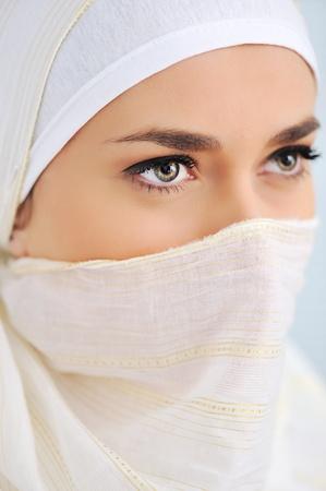 Muslim beautiful woman with scarf and veil, closeup photo