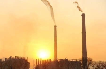 Industry, big chimney at sunset photo