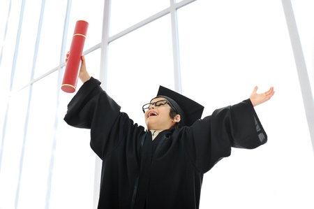Kid celebrating graduating diploma photo