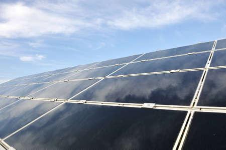 Alternative energy photovoltaic solar panels against blue sky Stock Photo - 12627175