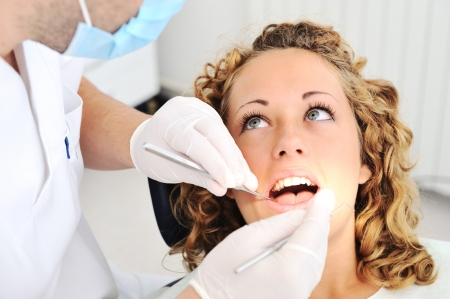 filling equipment: Teeth checkup at dentists office Stock Photo