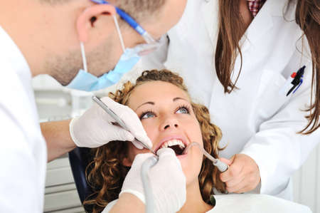 assistent: Teeth checkup at dentists office Stock Photo
