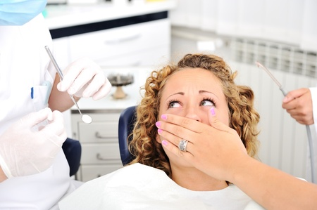frighten: Teeth checkup at dentists office Stock Photo