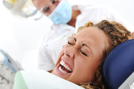 desease: Scared female at hospital, visiting dentist Stock Photo